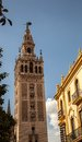 The famous sevillan giralda stands out as a landmark for the beautiful city on a beautiful day Stock Photos