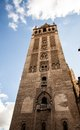 The famous sevillan giralda stands out as a landmark for the beautiful city on a beautiful day Stock Image