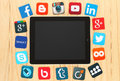 Famous social media icons placed around iPad