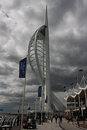 The famous Spinnaker Tower in the port of Portsmouth on the South coast of England with local business returning to their offices