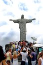 Famous statue of the chris in rio de janeiro christ redeemer tourists on corcovado hill brazil monument is best known Royalty Free Stock Photography
