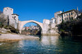 Famous touristic landmark old bridge in the city with old buildings mostar bosnia and herzegovina historical ottoman period and Royalty Free Stock Photo