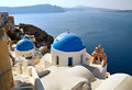 Famous view of santorini blue domed churches on the caldera background greece Stock Images