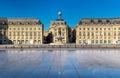 Famous water mirror fountain in front of Place de la Bourse in Bordeaux, France