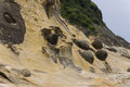 Famous yehliu ball shaped rocks is a cape on the north coast of taiwan in the town of wanli the cape known by geologists as the Stock Images