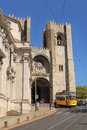 Famous yellow tram number in front of the lisbon cathedral april on april spain Stock Photos
