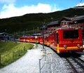 Famous yelow red swiss alpes train with sky and mountain away Stock Photo