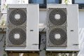 Fan coil units some installed outside a building it serve to condition the air within Royalty Free Stock Photography
