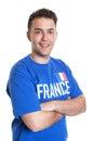 Fan de deportes francesa atractiva con los brazos cruzados Fotos de archivo