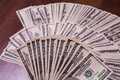 Fan of money a fan of new hundred dollar bills face thirst for wealth detail renting pocket Stock Photos