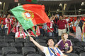 Fan waving the national flag of Portugal Stock Photos