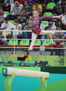 Fan Yilin of China competes during a balance beam event of women`s team final of Artistic Gymnastics at the 2016 Rio Olympic Games Royalty Free Stock Photo