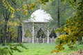Fancy arbor beautiful in autumn park surrounded by green grass Stock Images