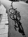 Fancy bike bw at the street with nice shadow image Stock Image