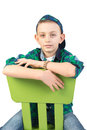 Fancy boy on green chair posing in studio Royalty Free Stock Image