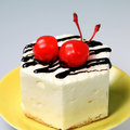 Fancy cake with cherry Royalty Free Stock Photos