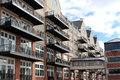 Fancy condominiums decks glassed overpass busy city street Royalty Free Stock Photography