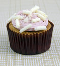 Fancy cupcake fanciful with strawberry cream and chocolate shavings Royalty Free Stock Photo
