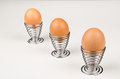 Fancy egg cups hardboiled eggs in Royalty Free Stock Photo