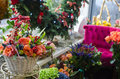 Fancy flowershop a market with flowers in baskets and nice decorations Stock Images