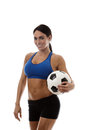 Fancy a game sexy woman wearing sports bra and short holding traditional football Royalty Free Stock Image