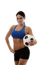 Fancy a game sexy woman wearing sports bra and short holding traditional football Stock Image