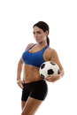 Fancy a game sexy woman wearing sports bra and short holding traditional football Stock Photos