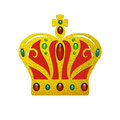 Fancy gold crown with inlaid jewels of ruby emerald and sapphires with red velvet cloth and gold cross on top Royalty Free Stock Photo