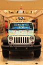 Fancy jeep suv with colorful design cover in shopping mall Stock Photo