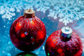 Fancy new year frozen balls with ice water drops bokeh on snowflakes winter background wallpaper Stock Image