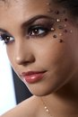 Fancy party makeup with rhinestones on beautiful model closeup facial portrait Stock Photography