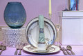 Fancy plate setting table with silver cutlery Royalty Free Stock Photos