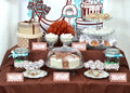 Fancy set table with sweets candies cake marshmallows zephyr homemade nuts almonds truffle as a present for birthday party Royalty Free Stock Images