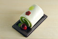 Fancy soap in roll cake form with cherry Royalty Free Stock Photo