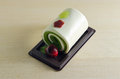 Fancy soap in rolled cake form with cherry Royalty Free Stock Photo