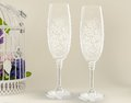 Fancy wedding goblets two glasses on tender background Stock Images