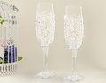 Fancy wedding goblets two glasses on tender background Royalty Free Stock Photo