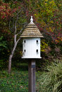 Fancy white bird house a offers economical and beautiful housing for birds in the area Royalty Free Stock Images