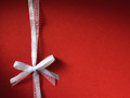 Fancy white ribbon gift bow on cardboard background Royalty Free Stock Photos
