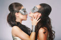 Fancy women in surrealistic stylized silver masks performance Royalty Free Stock Photo