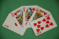 Fanned out winning hand poker royal flush on green baize table in playing cards spread a Royalty Free Stock Photo