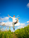 Fanny woman jumping over the blue sky Stock Images