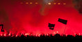 Fans burn flares at rock concert Stock Photo