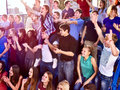 Fans clapping and shouting in the stands sport singing on tribunes group people large crowd Royalty Free Stock Images
