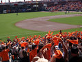 Fans wave orange towels pump up team before game Royalty Free Stock Photo