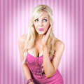 Fantastic blond pinup girl with surprised look lovely blonde pin up woman quirky of surprise wearing pink fashion pink lips stiped Royalty Free Stock Images