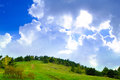 Fantastic cloudy sky over the forest and hill green Royalty Free Stock Photography