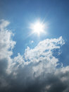 Fantastic sun and white clouds on the blue sky photo Royalty Free Stock Photo