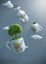 Fantastic tea world suspended with teapot and teacups Stock Image