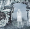 Fantastic transparent white woman ghost with a bloody hatchet in hand Stock Photo
